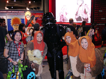 Groups of Ewoks with a Stormtrooper